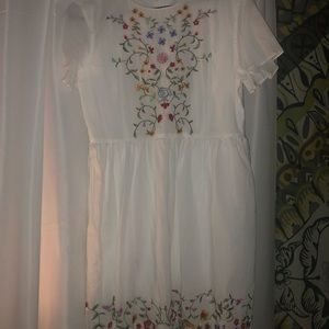 White dress with embroidery flowers